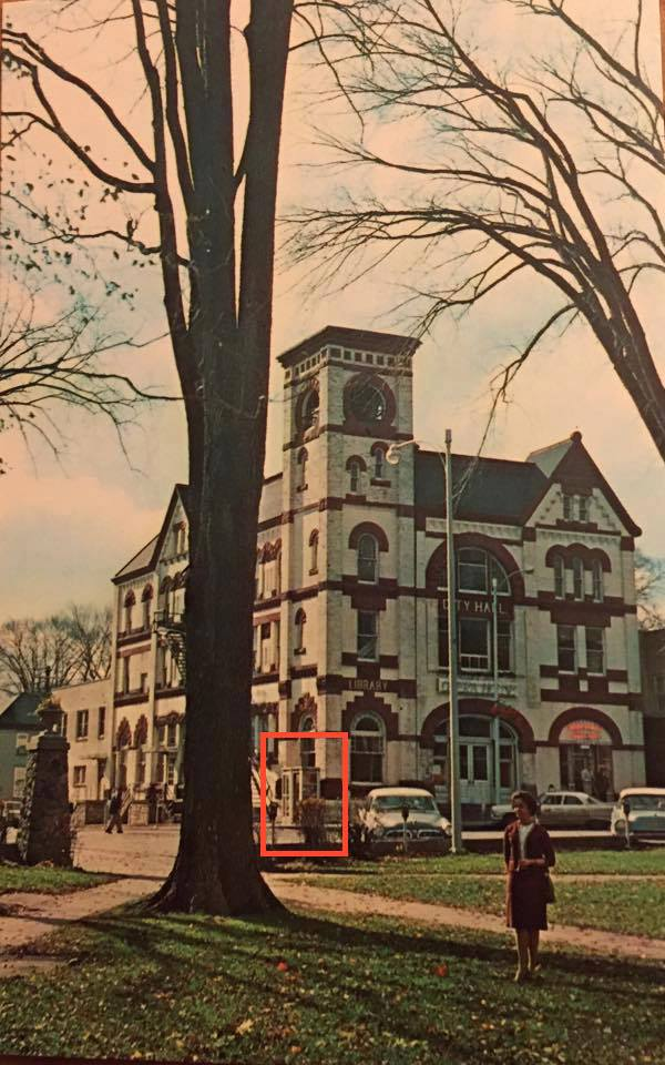 The fateful phone booth is outlined in red in this photo from the 1960s.